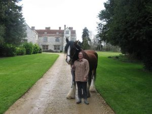 Simone with our sparky six year old, Royston, on the drive of the Library