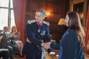 HM Lord-Lieutenant, Nigel Atkinson Esq congratulating Dr Sandy Lerner